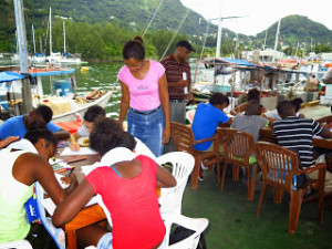 Children drawing the underwater wildlife at the fishing port