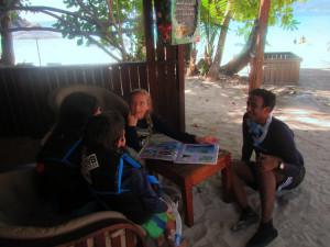 Krisha and Georgie working on the beach